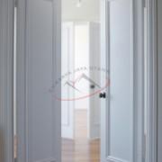 White door and hardwood floor